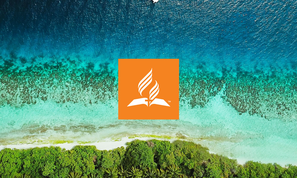 church logo superimposed over aerial view of island lagoon